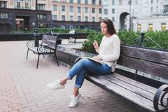 A young beautiful woman reads a paper book stock images