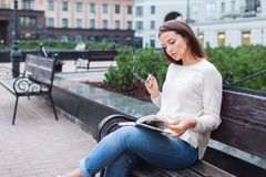 A young beautiful woman reads a paper book stock image