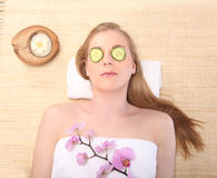 Young beautiful woman receiving facial massage and spa treatment Royalty Free Stock Photography