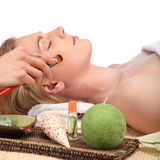 Young beautiful woman receiving facial massage and spa treatment Stock Photo