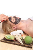 Young beautiful woman receiving facial massage and spa treatment Royalty Free Stock Photos