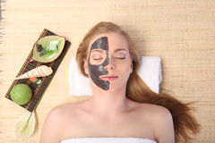 Young beautiful woman receiving facial massage and spa treatment Royalty Free Stock Image
