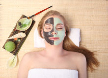 Young beautiful woman receiving facial massage and spa treatment Royalty Free Stock Images