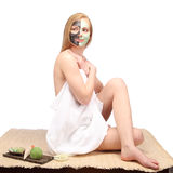 Young beautiful woman receiving facial massage and spa treatment Stock Image