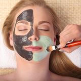 Young beautiful woman receiving facial massage and spa treatment Stock Photography