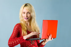 The young beautiful woman in  red blouse  with the Royalty Free Stock Photography