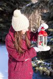 Young beautiful woman with red Christmas lantern Stock Images