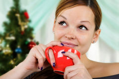 Young beautiful woman with a red cup Royalty Free Stock Images