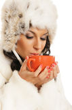 Young and beautiful woman with a red cup Stock Image