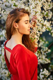 Young beautiful woman in red dress Stock Photography