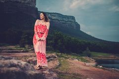 Young beautiful woman in red dress looking on mountains. Spain, Sant Roma de Sau. stock image