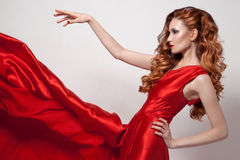 Young beautiful woman in red dress. Stock Photos