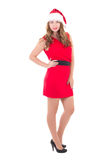 Young beautiful woman in red dress and santa hat isolated on whi Royalty Free Stock Image