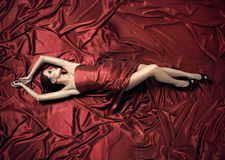 Young beautiful woman in red dress. Royalty Free Stock Photo