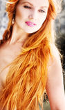 Young beautiful woman with red hair on natur Royalty Free Stock Image