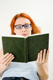 Young beautiful woman with red hair reading book Royalty Free Stock Image