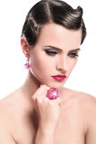 Young and beautiful woman with red jewelry Royalty Free Stock Photography