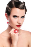 Young and beautiful woman with red jewelry royalty free stock photos