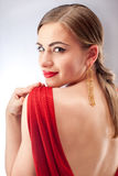 Young beautiful woman with red lips in red dress royalty free stock photo