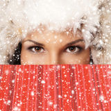 Young and beautiful woman with a red present Royalty Free Stock Photography
