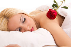 Young beautiful woman with red rose Stock Image