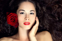Young beautiful woman with red rose. Portrait of young beautiful woman with red rose and healthy long hair Stock Photos