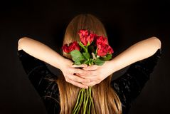 A young beautiful woman with red roses Stock Photography