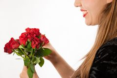 A young beautiful woman with red roses Royalty Free Stock Photo