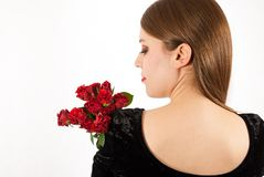 A young beautiful woman with red roses Royalty Free Stock Photos