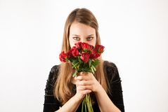 A young beautiful woman with red roses Stock Images
