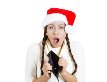Young beautiful woman in red santa claus hat, showing empty wallet Stock Photos