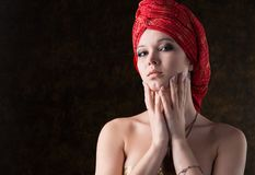 Beautiful woman in a red turban Stock Photo