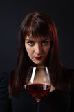 Young beautiful woman with red wine Royalty Free Stock Images