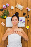Young beautiful woman relax in aroma spa wellness center. Relax at spa. Portrait of woman patient in ayurveda wellness center lies on wood with aroma spa royalty free stock photography
