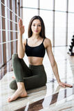 Young beautiful woman relax before doing yoga in yoga studio. Sport health concept. Stock Images