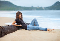 Young beautiful woman relax on the tropical beach. Vacation concept Stock Images