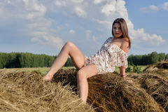 Young beautiful woman relaxes on hay Royalty Free Stock Image