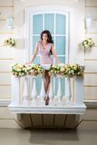 Young beautiful woman relaxing on a balcony Royalty Free Stock Photos
