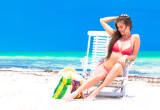 Young beautiful woman relaxing at beach Stock Image