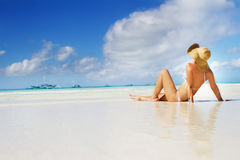 Young beautiful woman relaxing on beach Stock Images