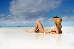 Young beautiful woman relaxing on beach Royalty Free Stock Photo
