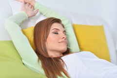 Young beautiful woman relaxing. In bed at home Royalty Free Stock Photos