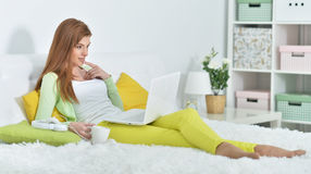 Young beautiful woman relaxing in bed at home Stock Photo