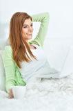 Young beautiful woman relaxing in bed at home Royalty Free Stock Photo
