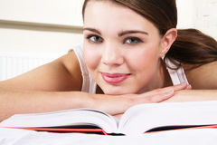 Young beautiful woman relaxing with a book Royalty Free Stock Images