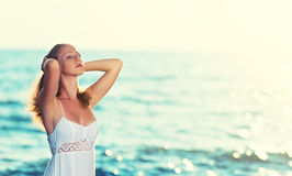 Young beautiful woman is relaxing and enjoying Royalty Free Stock Photography