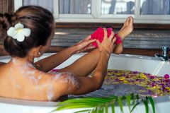 Free Young Beautiful Woman Relaxing In Bath With Foam And Tropical Flowers Petals,tropical Flowers Petals In Eco Hotel Bali Royalty Free Stock Photos - 159368518
