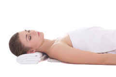 Young beautiful woman relaxing on a massage table isolated on wh Stock Image