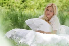 Young beautiful woman relaxing on nature Stock Images