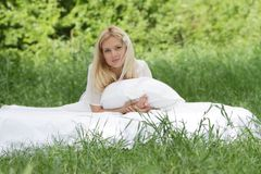 Young beautiful woman relaxing on nature Royalty Free Stock Photos